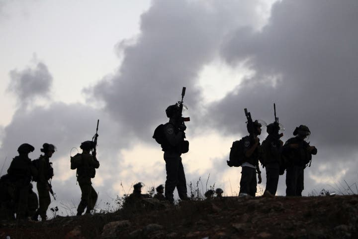 Israeli soldiers stand guard during a tense situation. (Image credit: AFP)