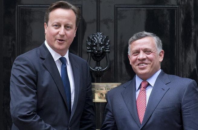 British Prime Minister David Cameron (L) greets Jordan's King Abdullah II at Number 10 Downing Street in central London on June 19 (Justin Tallis / AFP)