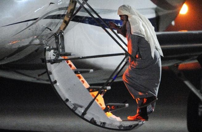 Radical Islamist cleric Abu Qatada boarding a privately chartered jet at the RAF Northolt base in west London, early on July 7, 2013, as he gets deported to Jordan.(AFP / MOD Crown Copyright)