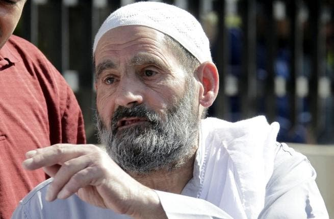 Omar Othman, the father of radical Islamist cleric Abu Qatada, stands outside the state security court in Amman on July 7 (AFP)