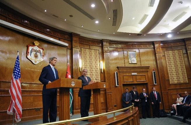 US Secretary of State John Kerry and Jordan's Foreign Minister Nasser give a joint press conference on July 17, 2013 at the Ministry of Foreign Affairs in the Jordanian capital, Amman. AFP PHOTO POOL MANDEL NGAN