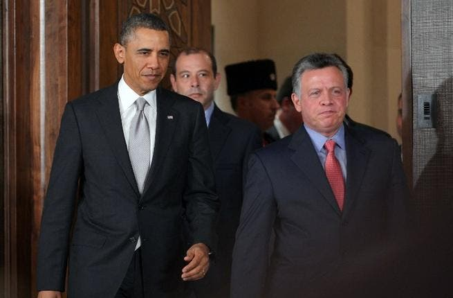 President Obama and King Abdullah arrive at a press conference (AFP Photo)