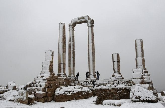 Men play after a snowstorm in January 2012 at the Amman Citidel. [wodumedia]