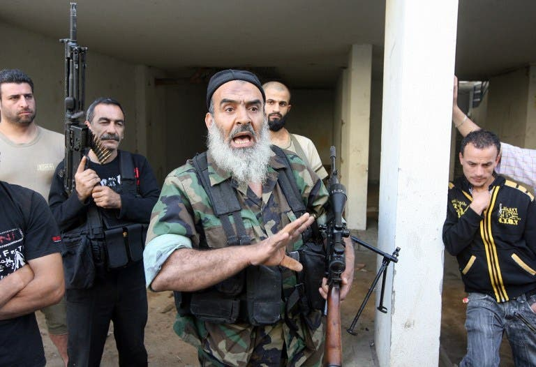 Sunni Salafist gunmen, who back the Syrian opposition, are seen in the northern Lebanese city of Tripoli on May 23 (AFP)