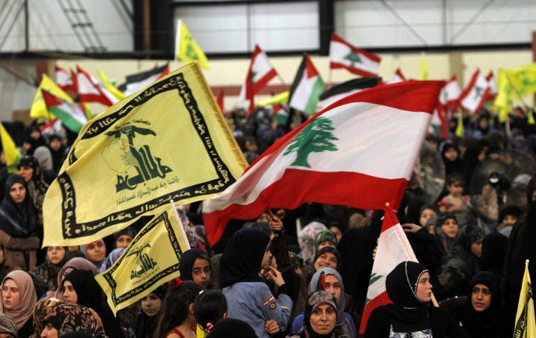 LEBANON, RWEISS : Lebanese women loyal to Hezbollah wave the national flag and Hezbollah flags during a gathering to mark the