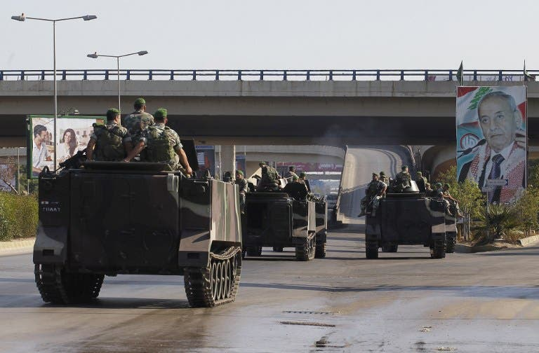 LEBANON, Beirut : Lebanese army troops patrol the airport road on the southern outskirts of Beirut on August 9, 2013, following the kidnapping by gunmen early in the morning of two pilots working for Turkish Airlines on the road leading to the airport. AFP PHOTO / ANWAR AMRO