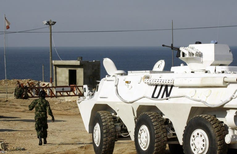 United Nations Interim Force in Lebanon (UNIFIL) troops stand guard at the Ras al-Naqura checkpoint on the Lebanese-Israeli border on December 16, 2013 following crossfire between Israeli and Lebanese forces the previous evening. [AFP]