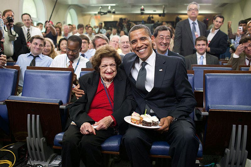President Barack Obama presents cupcakes with a candle to Hearst White House columnist Helen Thomas in honor of her birthday in the James Brady Briefing Room, on Aug. 4, 2009. Thomas, who turned 89, shares the same birthday as the President, who turned 48. (Source: Official White House Photostream/Pete Souza)