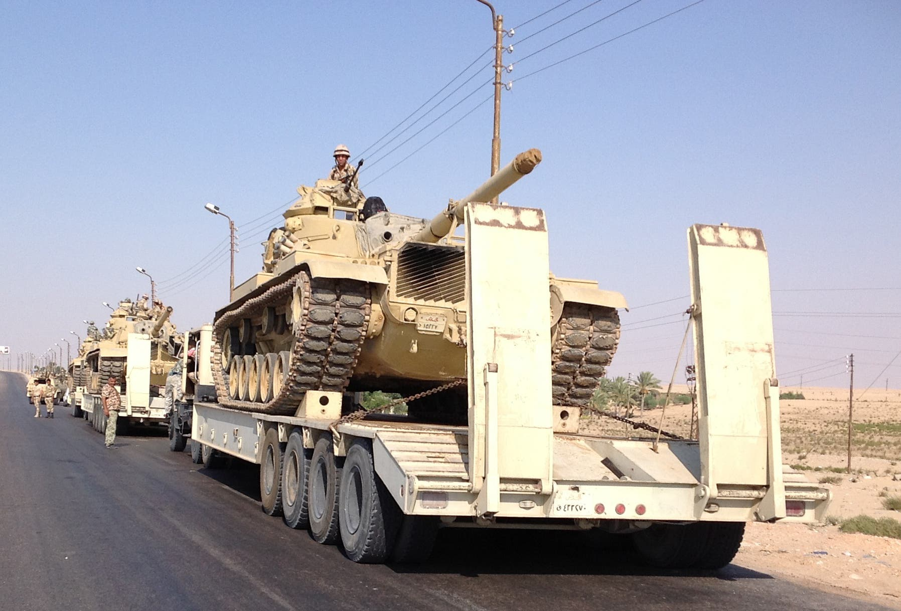 Egyptian military tanks are deployed in the northern Sinai town of Al-Arish (AFP/STR)