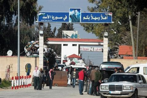 Syrians crossing into Lebanon on March 22 (Daily Star/ Nidal Solh)