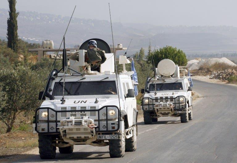 LEBANON, KFAR KILA : Peacekeepers of the United Nations Interim Force in Lebanon (UNIFIL) patrol along the Lebanese-Israeli border on August 23, 2013 in Kfar Kila after the Israeli air force launched a rocket toward a Palestinian group in Lebanon. AFP PHOTO MAHMOUD ZAYYAT