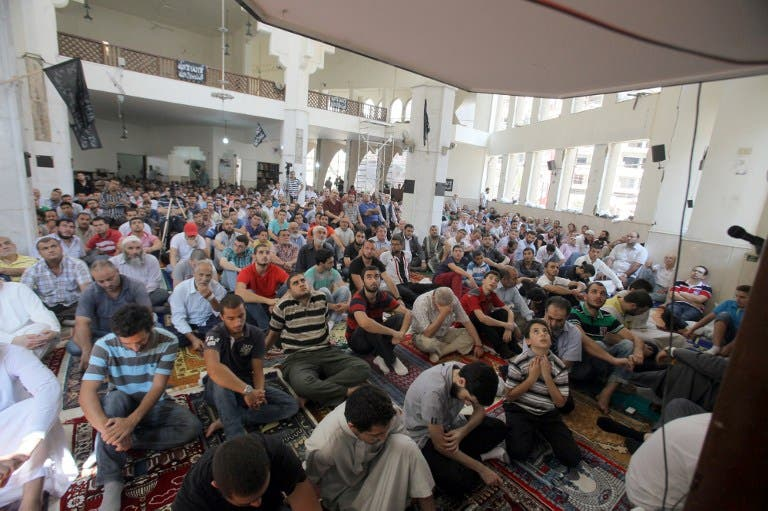 LEBANON, Tripoli : People perform the Friday prayer on August 31, 2013, inside Al-Salam mosque that was targeted with a car bomb a week ago in the northern Lebanese port city of Tripoli. AFP PHOTO STR