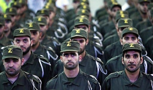 Hezbollah troops stand in formation in Lebanon (AFP file photo)