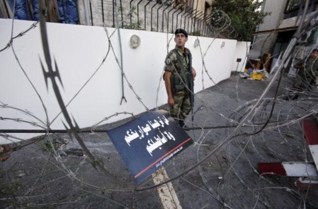 Lebanese soldiers block a road leading to the American embassy in eastern Beirut. (Image credit: AFP)