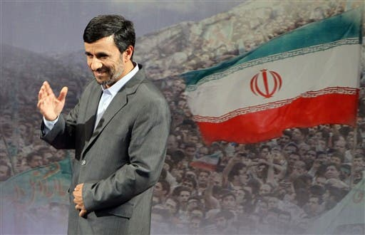 """IRAN, Tehran : Iranian President Mahmoud Ahmadinejad gestures after speaking to the press in Tehran on June 28, 2010, saying that Iran will """"discipline"""" the West by holding off talks with world powers over Tehran's nuclear programme until the end of August."""