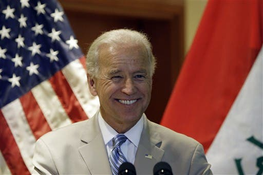 IRAQ, Baghdad : US Vice President Joe Biden smiles during his address to US troops during a naturalisation ceremony at Al-Faw Palace in Baghdad's Camp Victory on July 4, 2010.