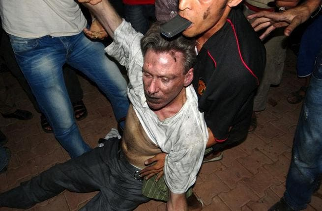 Libyan civilians help an unconscious man, identified by eyewitnesses as US ambassador to Libya, Chris Stevens, at the US consulate compound in Benghazi, following an overnight attack on the building. Stevens and three of his colleagues were killed. (AFP PHOTO/STR)