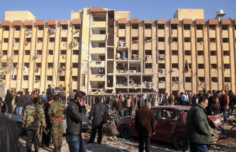 Syrian's gather at the scene of an explosion outside Aleppo University, between the university dormitories and the architecture faculty, on Tuesday. (AFP PHOTO/STR)