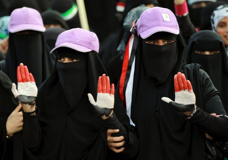 Women, whose hands are painted with Yemen's colours, take part in a rally marking the first anniversary of the ouster of autocratic leader Ali Abdullah Saleh. (AFP PHOTO/ MOHAMMED HUWAIS)