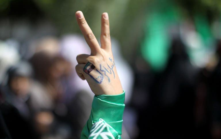 A Palestinian protester whose hand reads in Arabic