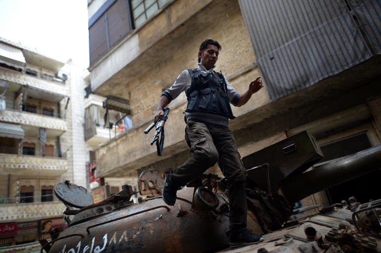 A Syrian rebel patrols an area in the Sheikh Maqsud district of the northern Syrian city of Aleppo, on Thursday. (AFP PHOTO / DIMITAR DILKOFF)