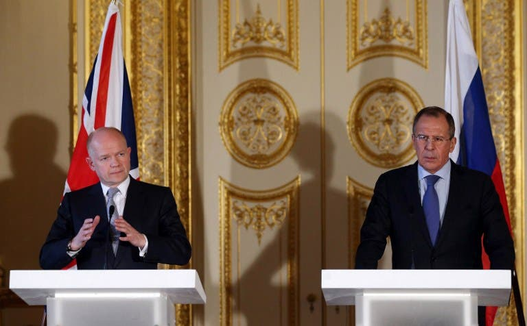 British Foreign Secretary William Hague (L) and his Russian counterpart Sergei Lavrov (R) hold a joint press conference at the Foreign and Commonwealth Office in London. (AFP PHOTO/POOL/OLI SCARFF)