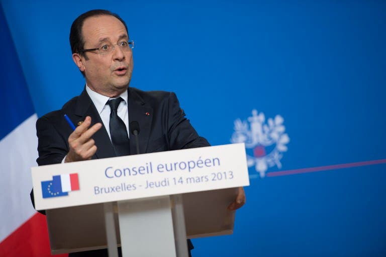 French President Francois Hollande attends a press conference at the EU Headquarters on Thursday in Brussels. (AFP PHOTO / BERTRAND LANGLOIS)