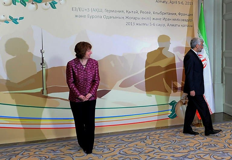 EU foreign policy chief Catherine Ashton (L) looks at Iran's top nuclear negotiator Saeed Jalili (R) leaving the podium after their meeting on the sidelines of the Iran's talks with world powers representatives on Iran's nuclear programme in the Kazakh city of Almaty. (AFP PHOTO /ILYAS OMAROV)