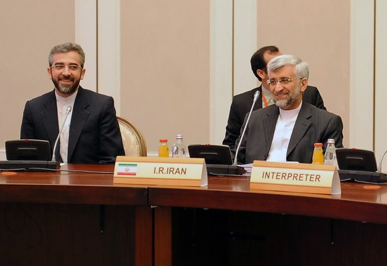 Iran's representatives led by their top nuclear negotiator Saeed Jalili (R) take part in talks with top officials from the United States, Britain, France, EU, China, Germany and Russia on Iran's nuclear program. (AFP PHOTO /ILYAS OMAROV)