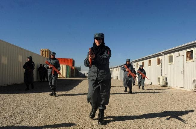Afghanistan National Police during a training exercise at a police academy outside Herat on Christmas Day. (AFP PHOTO/ AREF KARIMI)
