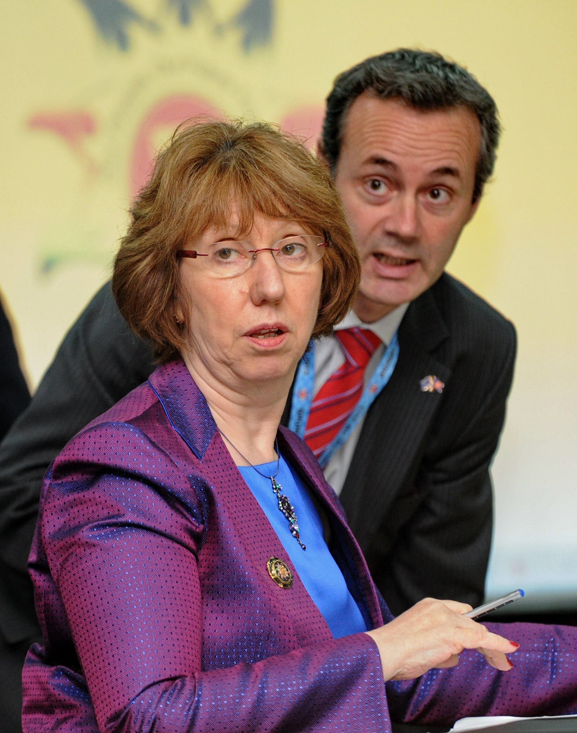 EU foreign policy chief Catherine Ashton and Bahraini FM Sheikh Khalid bin Ahmed al-Khalifa speak at the meeting on Syria. (AFP)