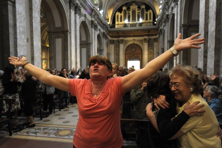 Faithful react after the announcement that Buenos Aires archbishop Jorge Mario Bergoglio was elected Pope Francis I, at Metropolitan Cathedral in Buenos Aires on Wednesday. (AFP PHOTO/JUAN MABROMATA)