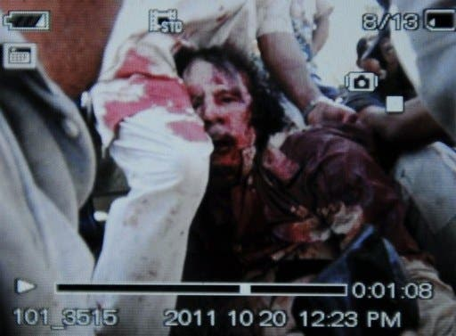 An image captured off a cellular phone camera shows the arrest of Libya's strongman Moammer Gaddafi.