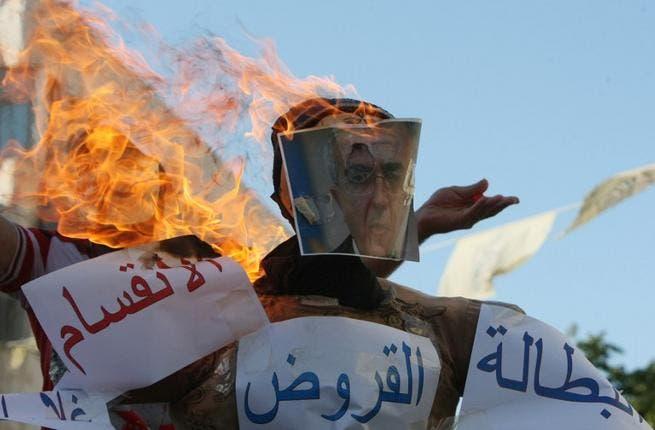 Protestors burned effigies of Prime Minister Salam Fayyad