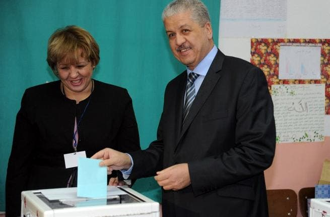Algerian prime minister, Abdelmalek Sellal, casts his vote at a polling station in Algiers, during local elections on Thursday. (AFP PHOTO/FAROUK BATICHE)