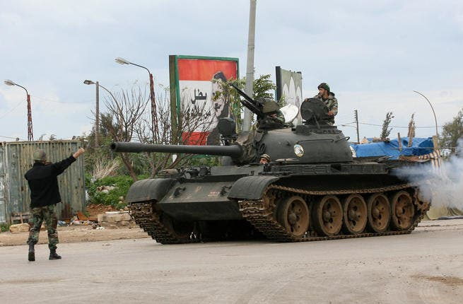 A Lebanese army tank patrols the streets of Tripoli four days ago, during violence between Sunni Muslim districts and neighbouring areas populated by Alawites. (AFP PHOTO / STR)