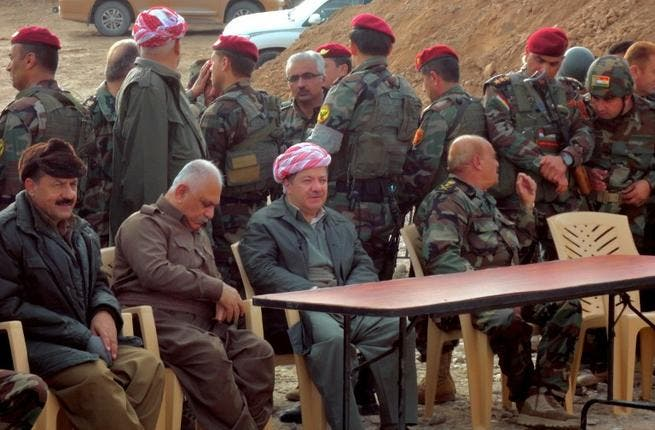 Massud Barzani, the president of Iraq's autonomous Kurdistan region (C-bottom) sits amidst Kurdish peshmerga security forces during a visit to the disputed north Iraq province of Kirkuk. (AFP PHOTO/MARWAN IBRAHIM)