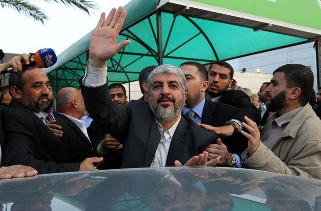Khaled Meshaal waves as he leaves the Gaza Strip on Monday (AFP PHOTO / HO / ISMAIL HANIYA'S OFFICE)