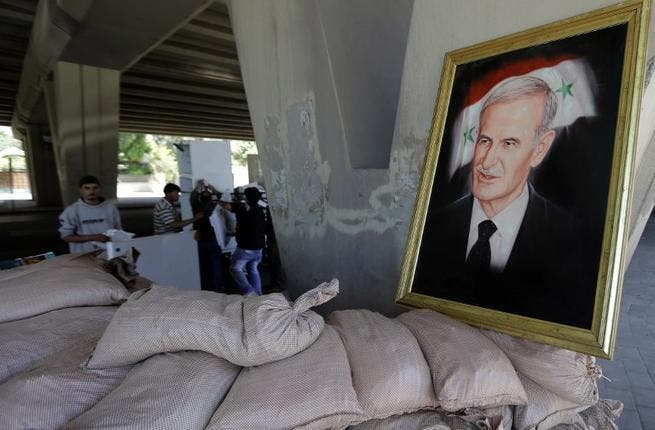 A picture of late Syrian president, Hafez al-Assad, father of current President Bashar al-Assad, seen at an army checkpoint in Damascus. (AFP PHOTO/JOSEPH EID)
