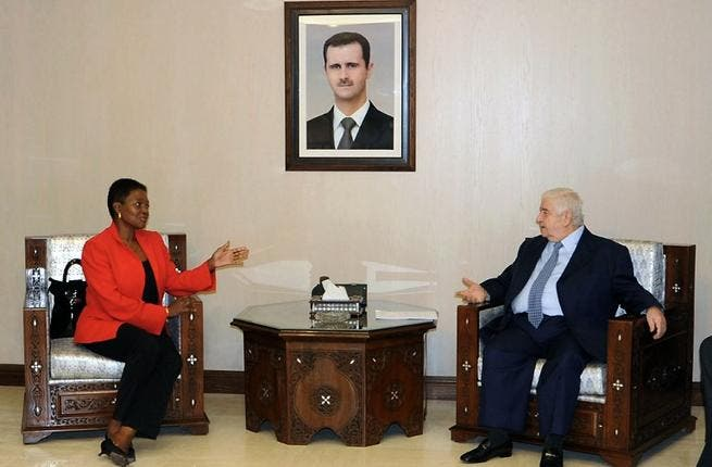 Syrian Foreign Minister Walid Muallem (R) speaks with UN humanitarian chief Valerie Amos during a meeting in Damascus on December Saturday. Muallem called on the United Nations to intervene and lift sanctions imposed on Syria, SANA reported. (AFP PHOTO/HO/SANA)
