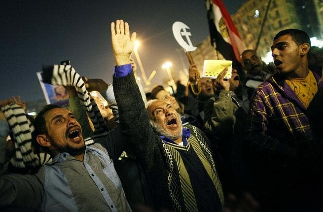An Egyptian opposition supporter shouts political slogans as hundreds of protesters demonstrated against President Mohammed Morsi in Cairo's landmark Tahrir square on Tuesday. (AFP PHOTO/MAHMOUD KHALED)