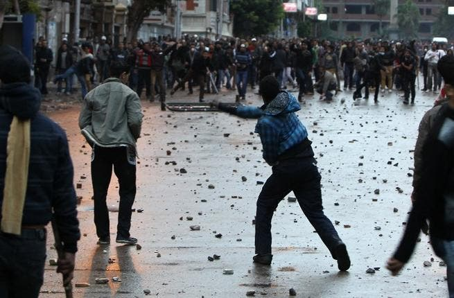 Egyptian opponents and supporters of President Morsi clash in Alexandria on Thursday. (AFP)