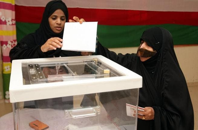 An Omani woman casts her vote at a polling station in the al-Khaburah district, on Saturday. (AFP)
