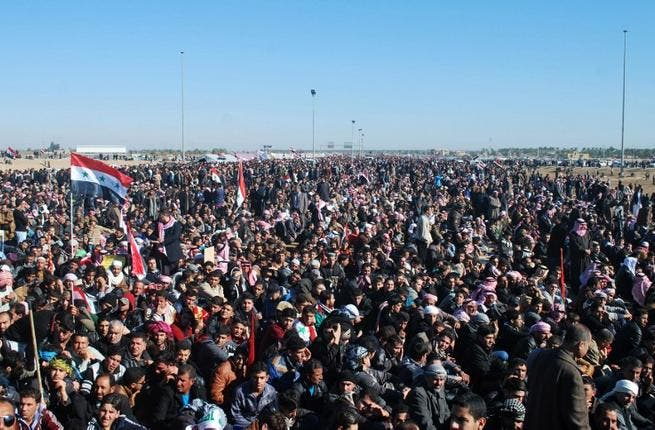 Iraqi protestors call for the release of prisoners they allege were arrested on sectarian grounds by Iraq's Shiite-led authorities during a demonstration in Ramadi, Anbar's provincial capital, on Friday. (AFP)