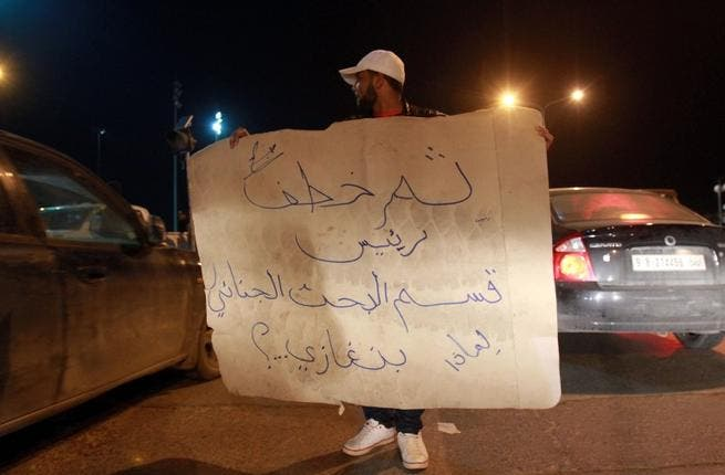 Libyan policemen in civilian clothing protest against the kidnapping of the Head of Criminal Investigation Department, Abdel Salam al-Mahdawi, outside the Tibesti hotel in Benghazi, on Thursday. (AFP PHOTO / ABDULLAH DOMA)