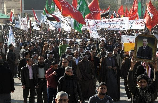 Iraqi protestors gather in support of Prime Minister Nuri al-Maliki in the city of Karbala, southwest of Baghdad, on Tuesday. (AFP PHOTO / STR)