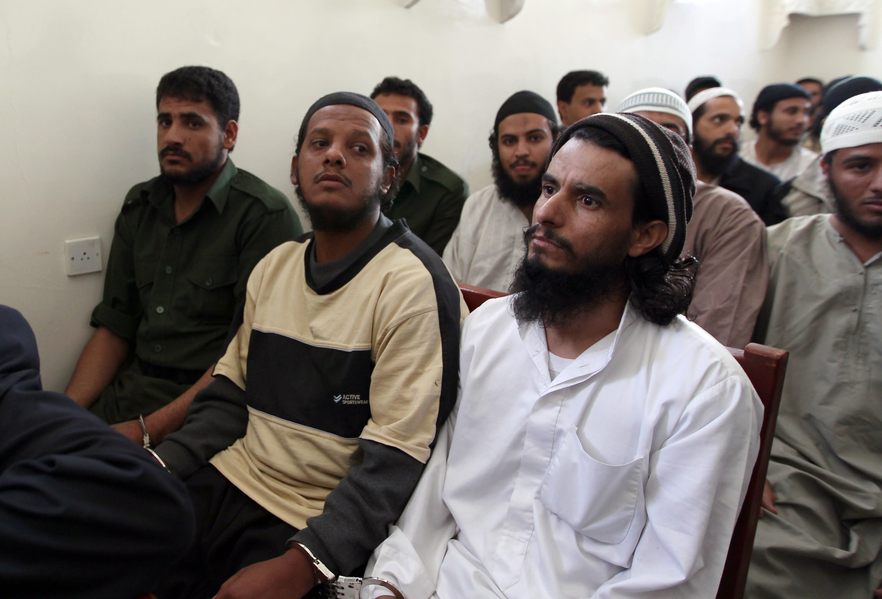 Suspected al-Qaeda militants attend their trial at a state security court in Sana'a on Tuesday. Photo for illustration purposes only. (Mohammed Huwais/AFP)