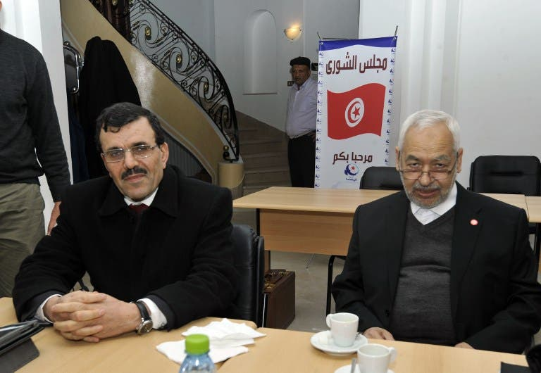 Interior Minister Ali Larayedh and Ennahda ruling party's leader Rached Ghannouchi pose before a meeting at the party's headquarters on Friday. (AFP PHOTO / FETHI BELAID)