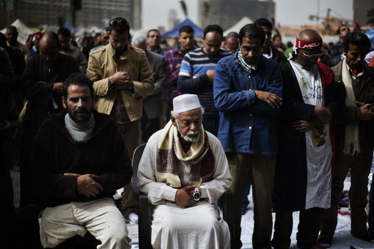 Egyptian anti-government protestors perform Friday prayers ahead of a demonstration on Friday. (AFP PHOTO/GIANLUIGI GUERCIA)