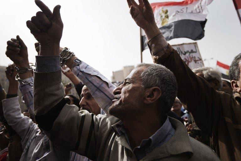 Egyptian anti-government protestors shout slogans against Egypt's President Mohamed Morsi during a demonstration in Cairo's landmark Tahrir square. (AFP PHOTO/GIANLUIGI GUERCIA)